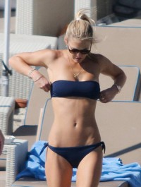Bar Refaeli smolders in navy swimsuit while holidaying in Greece
