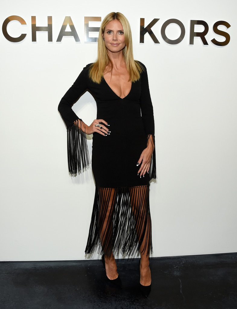 Heidi Klum stuns in tasseled dress during Michael Kors fashion show