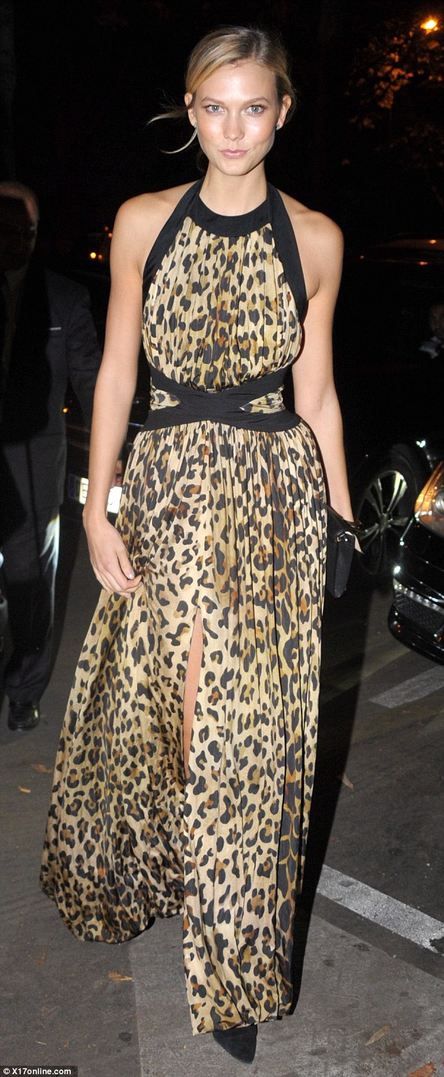 Karlie Kloss dazzles in animal print maxi dress during Paris Fashion Week bash
