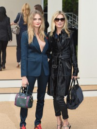 Kate Moss and Cara Delevingne show up hand in hand for the Burberry show in London