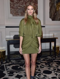 Rosie Huntington-Whiteley allures in olive number at Balmain after party