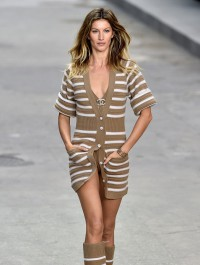 Gisele Bundchen stomps the streets at the feminist-themed Chanel fashion show