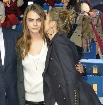 Cara Delevingne gets a kiss on the cheek from Kate Moss