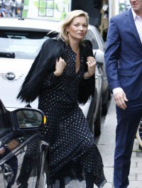 Kate Moss heads out for lunch in eye-catching polka-dotted number