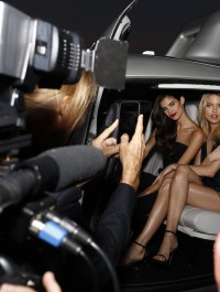 Sara Sampaio and Martha Hunt chopper into Florida for Russell James book event