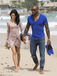 Shanina Shaik and beau indulge in lunch and a barefoot beach stroll