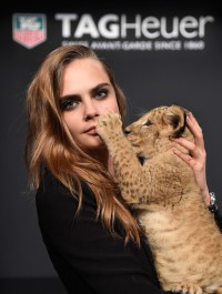 Cara Delevingne cuddles up to lion cub for watch event