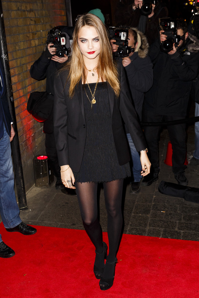 Cara Delevingne dons tasseled LBD at YSL Beauty party