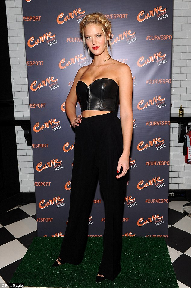Erin Heatherton stuns in all-black getup at fragrance launch