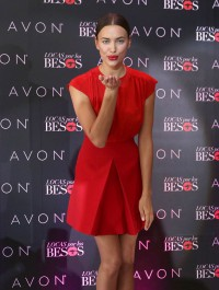 Irina Shayk dazzles in red as she launches a lipstick in Mexico