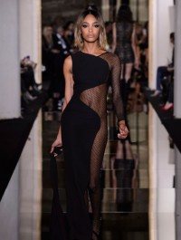 Jourdan Dunn stuns in half-revealing dress during Atelier Versace show