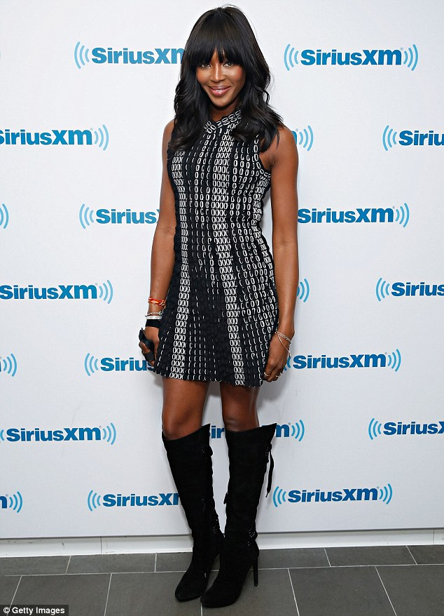 Naomi Campbell stuns in printed mini dress as she promotes TV show