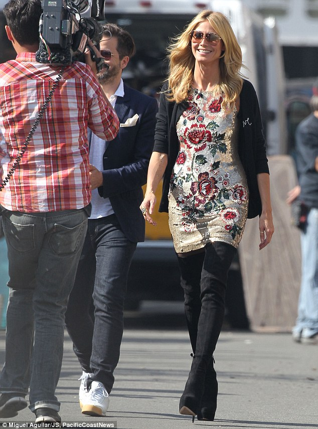 Heidi Klum films TV show scenes in sequined floral mini dress