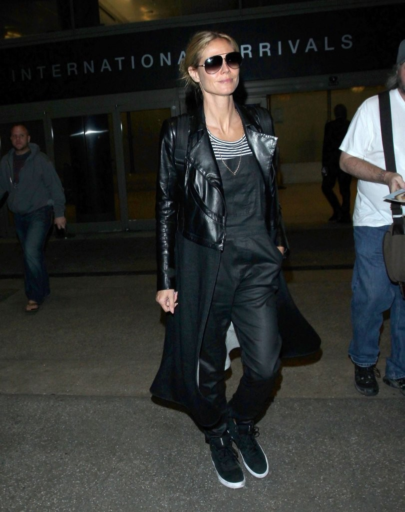 Heidi Klum takes to the skies in leather overalls and matching jacket