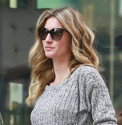 Gisele Bundchen covers up in a woolly sweater despite NYC heat