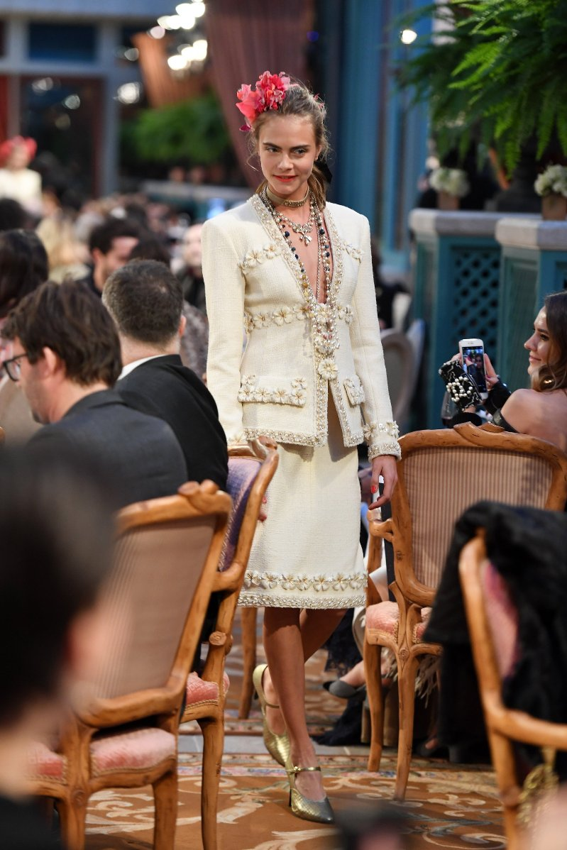 Cara Delevingne and Lily-Rose Depp walk the Chanel Metiers d\'Art show